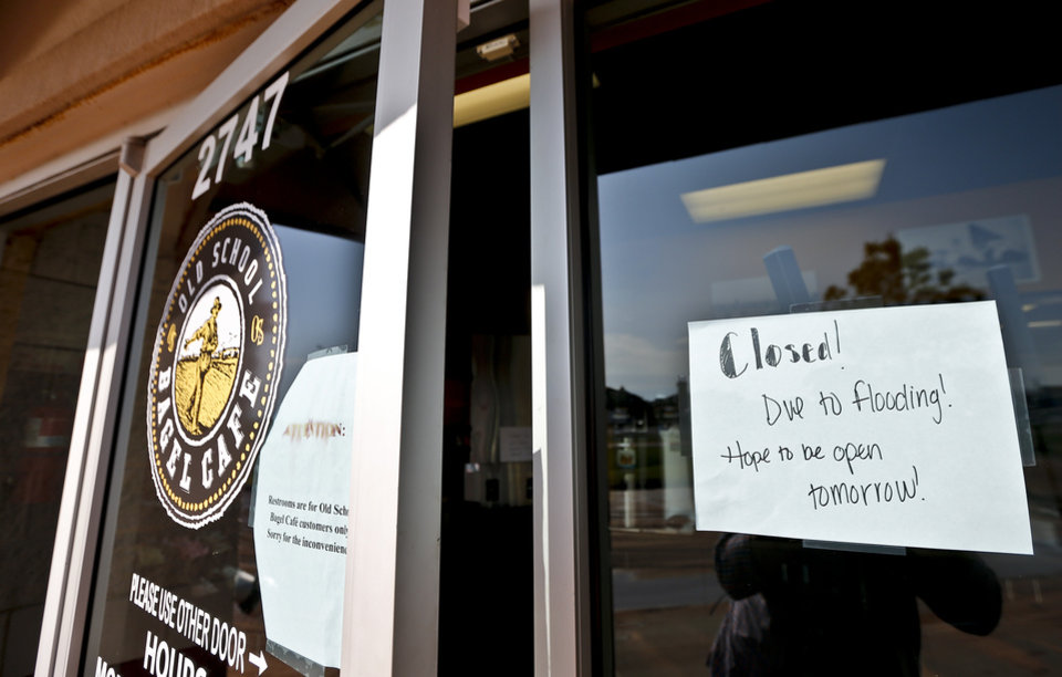 Photo - The Old School Bagel Cafe closed shop for the day to clean up storm damage in Moore, Okla. on Thursday, May 7, 2015. After the business was flooded by Wednesday's storms. Photo by Chris Landsberger, The Oklahoman