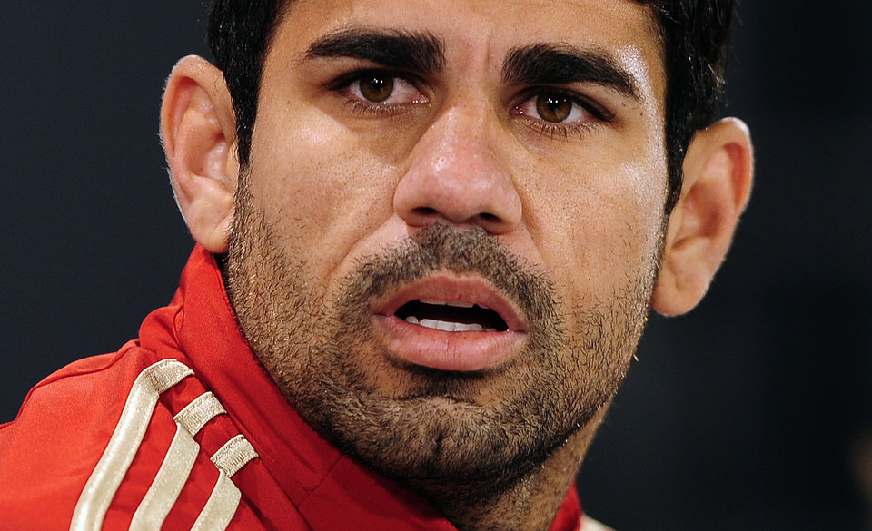 Photo - Spain's Diego Costa attends a press conference at the Atletico Paranaense training center in Curitiba, Brazil, Tuesday, June 10, 2014. Spain will play in group B of the Brazil 2014 soccer World Cup. (AP Photo/Manu Fernandez)