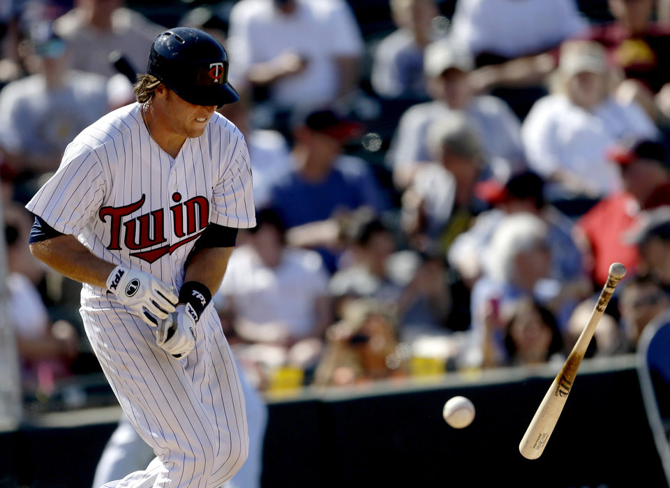 Photo - Minnesota Twins' Danny Lehmann is hit by a pitch in the seventh inning of a spring training exhibition baseball game against the Pittsburgh Pirates Sunday March 10, 2013, in Fort Myers, Fla. Pittsburgh won 7-4. (AP Photo/David Goldman)