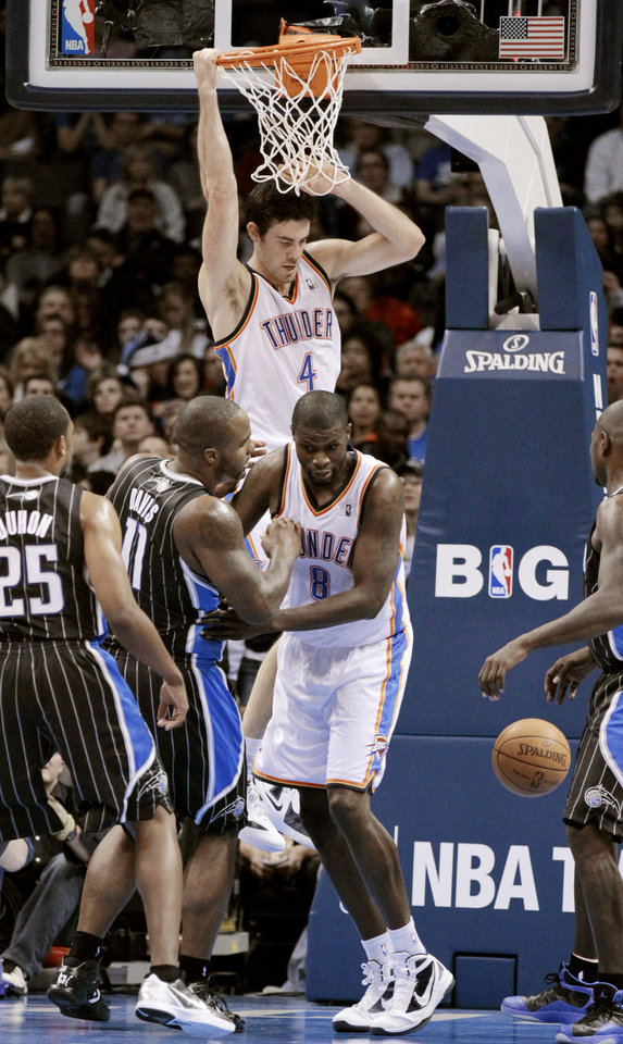 Oklahoma City Thunder's Nick Collison (4) scores in the first half as the Oklahoma City Thunder play the Orlando Magic in NBA basketball at the Chesapeake Energy Arena on Sunday, Dec. 25, 2011, in Oklahoma City, Okla.  Photo by Steve Sisney, The Oklahoman