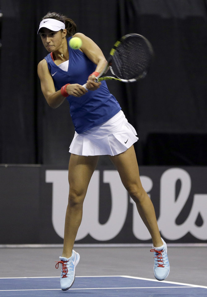 Photo - France's Caroline Garcia returns a ball to United States' Madison Keys during a Fed Cup singles world group playoff tennis match Sunday, April 20, 2014, in St. Louis. Garcia won 6-4, 6-3.(AP Photo/Jeff Roberson)