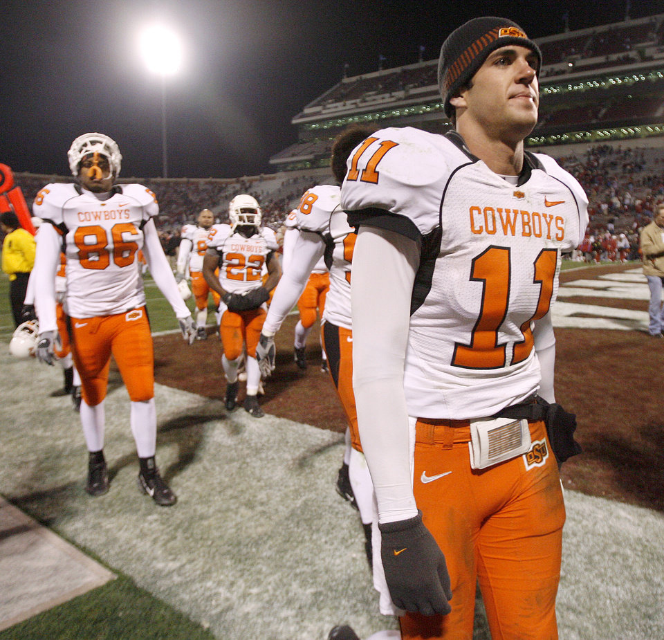 Photo - Zac Robinson of OSU walks off the field after the college football game between the University of Oklahoma Sooners (OU) and the Oklahoma State University Cowboys (OSU) at the Gaylord Family-Memorial Stadium on Saturday, Nov. 24, 2007, in Norman, Okla.  Photo By Bryan Terry, The Oklahoman