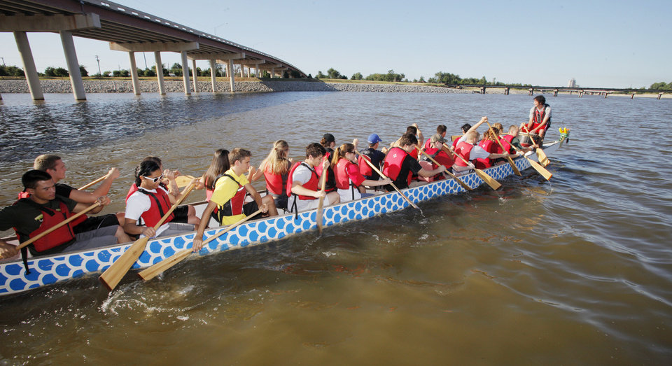 Photo - Students go boating in a dragon boat on the Oklahoma River during Four Star Leadership summer camp in Oklahoma City.  PAUL B. SOUTHERLAND - THE OKLAHOMAN