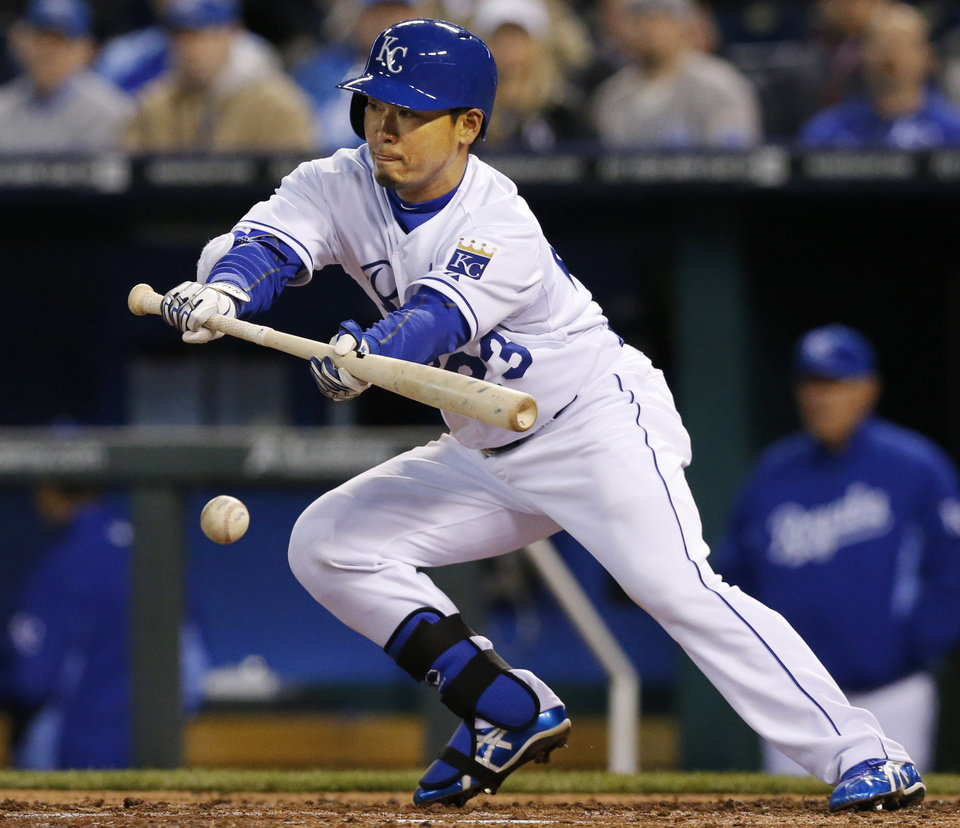 Photo - Kansas City Royals' Norichika Aoki bunts for a hit during the third inning of a baseball game against the Tampa Bay Rays at Kauffman Stadium in Kansas City, Mo., Tuesday, April 8, 2014. Aoki's bunt loaded the bases. (AP Photo/Orlin Wagner)