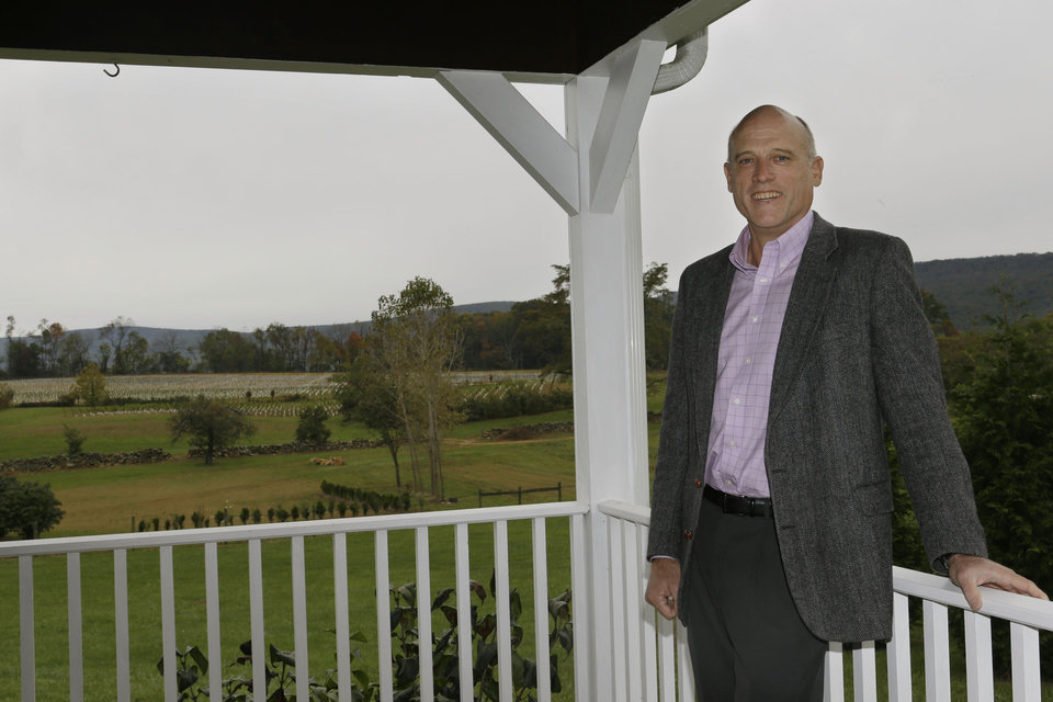 Photo -   ADVANCE FOR USE SUNDAY, OCT. 14, 2012 AND THEREAFTER - In this Monday, Oct. 8, 2012 photo, Chris Charron, one of three owners of the 868 Estate Vineyards, poses for a portrait on the winery grounds in Purcellville, Va. Charron recently sold his construction consulting company, nervous about how the business - 80 percent involved government contracts - would fare in this era of budget cutbacks. He also was impatient with the pace of recovery. Now part owner of the winery and the adjoining restaurant, Charron is relieved he no longer works with federal bureaucrats. (AP Photo/Jacquelyn Martin)
