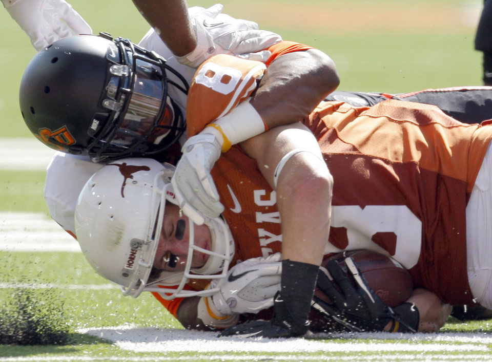 Photo - Oklahoma State's Justin Gilbert (4) tackles Texas' Jaxon Shipley (8) during first half of a college football game between the Oklahoma State University Cowboys (OSU) and the University of Texas Longhorns (UT) at Darrell K Royal-Texas Memorial Stadium in Austin, Texas, Saturday, Oct. 15, 2011. Photo by Sarah Phipps, The Oklahoman