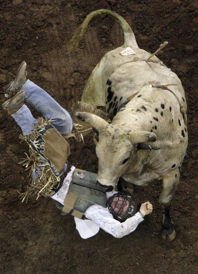 Marc Deslandes of St.Liboire Quebec Canada is thrown from a bull during the bull riding event at the 42nd annual International Rodeo Finals at the State Fair Arena in Oklahoma City, Sunday, Jan. 15, 2012. Photo by Sarah Phipps, The Oklahoman