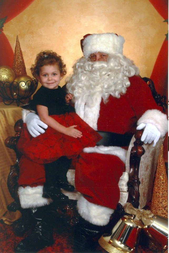 Celia Elizabeth Bruner and Santa at Farmers Insurance Call Center in Shepherd Mall.<br/><b>Community Photo By:</b> Santa's helper<br/><b>Submitted By:</b> Kellie, Bethany