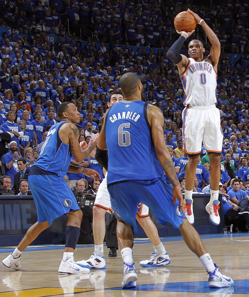 Oklahoma City\'s Russell Westbrook (0) puts up a three point shot over Tyson Chandler (6) of Dallas during game 3 of the Western Conference Finals of the NBA basketball playoffs between the Dallas Mavericks and the Oklahoma City Thunder at the OKC Arena in downtown Oklahoma City, Saturday, May 21, 2011. Photo by Chris Landsberger, The Oklahoman
