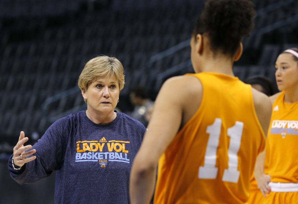 Photo - Tennessee head coach Holly Warlick talks with Tennesse forward Cierra Burdick (11) during the press conference and practice day at the Oklahoma City Regional for the NCAA women's college basketball tournament at Chesapeake Arena in Oklahoma City, Friday, March 29, 2013. Photo by Sarah Phipps, The Oklahoman