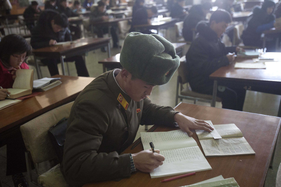 Photo - A North Korean soldier attends a class at the Grand Peoples Study House in Pyongyang, North Korea on Wednesday, Jan. 9, 2013. (AP Photo/David Guttenfelder)