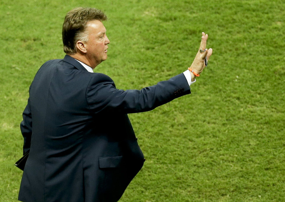 Photo - Netherlands' head coach Louis van Gaal gives indications during the World Cup quarterfinal soccer match between the Netherlands and Costa Rica at the Arena Fonte Nova in Salvador, Brazil, Saturday, July 5, 2014. (AP Photo/Themba Hadebe)