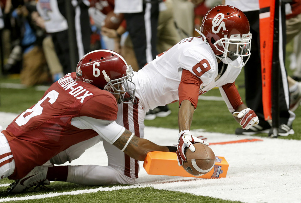 Oklahoma's Jalen Saunders (8) dives for a touchdown as Alabama's Ha Ha Clinton-Dix (6) tackles him during the NCAA football BCS Sugar Bowl game between the University of Oklahoma Sooners (OU) and the University of Alabama Crimson Tide (UA) at the Superdome in New Orleans, La., Thursday, Jan. 2, 2014.  .Photo by Sarah Phipps, The Oklahoman