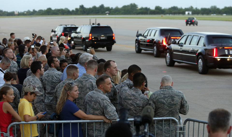 Photo - A crowd watches President Barack Obama leave after arriving on Air Force One at Tinker Air Force Base in Midwest City, Wednesday, July 15, 2015. President Barack Obama will visit the Federal Correctional Institution El Reno, where he will meet with Oklahoma law enforcement officials and inmates and conduct an interview for a documentary scheduled to air in the fall. Photo by Bryan Terry, The Oklahoman