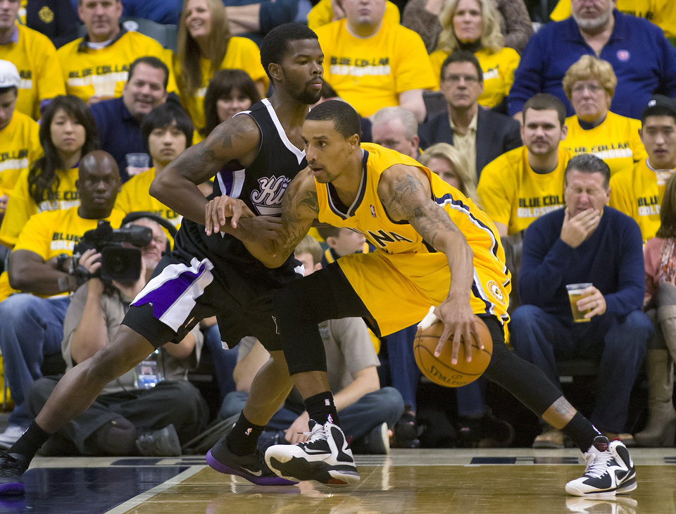 Indiana Pacers' George Hill works the ball inside against Sacramento Kings' Aaron Brooks during an NBA basketball game in Indianapolis on Saturday, Nov. 3, 2012. (AP Photo/Doug McSchooler)
