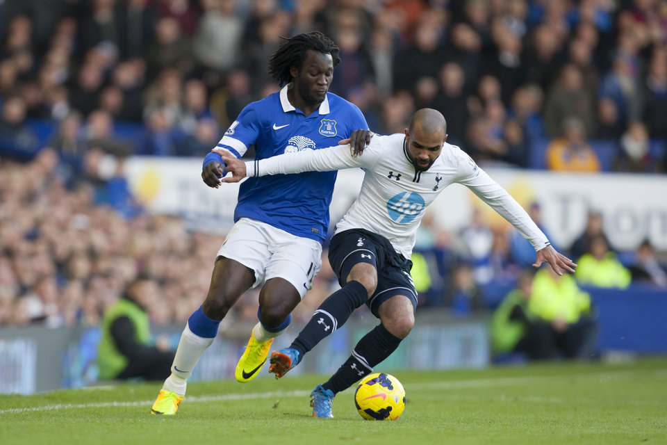 Photo - Everton's Romelu Lukaku, left, fights for the ball against Tottenham's Sandro during their English Premier League soccer match at Goodison Park Stadium, Liverpool, England, Sunday Nov. 3, 2013. (AP Photo/Jon Super)