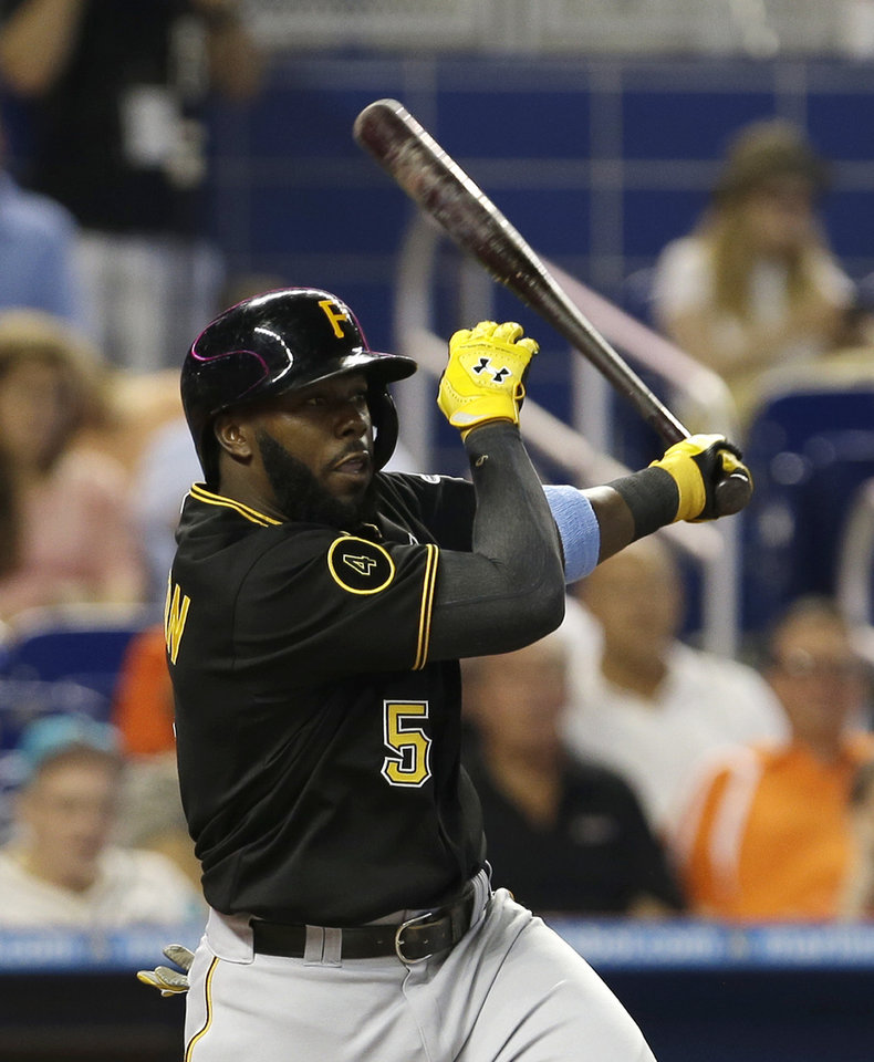 Photo - Pittsburgh Pirates' Josh Harrison follows through on a base hit against the Miami Marlins in the fourth inning of a baseball game in Miami, Sunday, June 15, 2014. Pirates' Russell Martin scored on the single. (AP Photo/Alan Diaz)