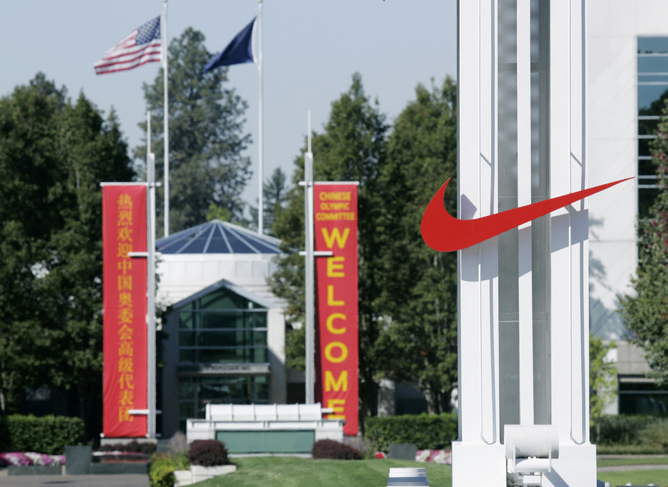 FILE - In this Sept. 29, 2006 file photo, the red Nike swoosh marks the entrance to the company\'s headquarters campus in Beaverton, Ore. Nike wants to expand its Oregon operations and hire as many as 12,000 new workers by 2020 but wants the government to promise it won\'t change the state tax code. Oregon Gov. John Kitzhaber says he\'ll call the Legislature into session Friday to create a law to give Nike its promise. (AP Photo/Don Ryan, File)