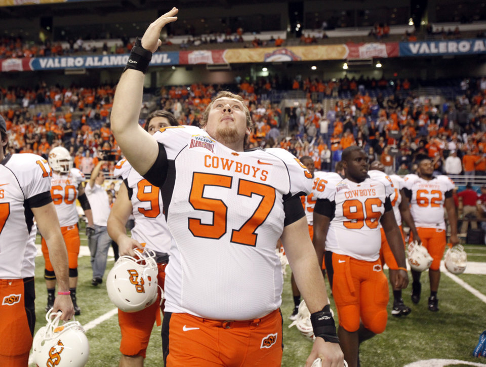 Photo - Oklahoma State's Chuck Major (57)celebrates the Cowboys' win over Arizona in the Valero Alamo Bowl  at the Alamodome in San Antonio, Texas, Wednesday, December 29, 2010. OSU won, 36-10. Photo by Sarah Phipps, The Oklahoman
