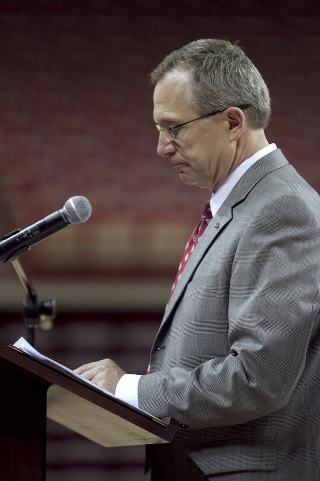 Photo -   Arkansas athletic director Jeff Long talks to reporters about the firing of football coach Bobby Petrino, during a news conference in Fayetteville, Ark., Tuesday, April 10, 2012. (AP Photo/Gareth Patterson)