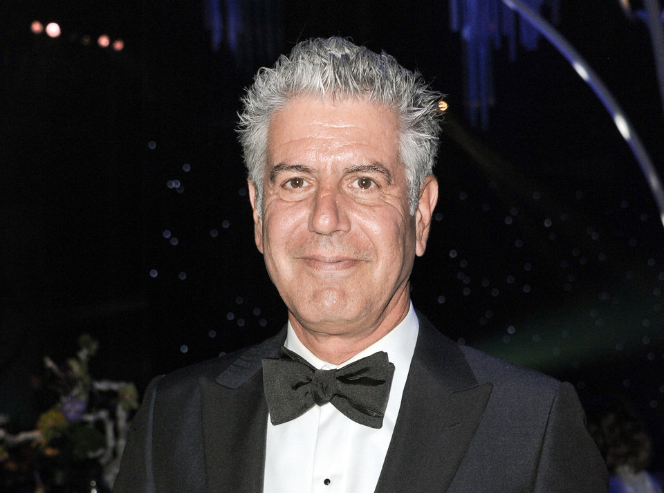 """Photo - FILE - This Sept. 15, 2013 file photo shows Anthony Bourdain at the 2013 Primetime Creative Arts Emmy Awards Governors Ball in Los Angeles. Bourdain was honored for the on-location television category for """"The Mind of a Chef,"""" at the James Beard Foundation awards on  Friday, May 2, 2014. (Photo by Richard Shotwell/Invision/AP, File)"""