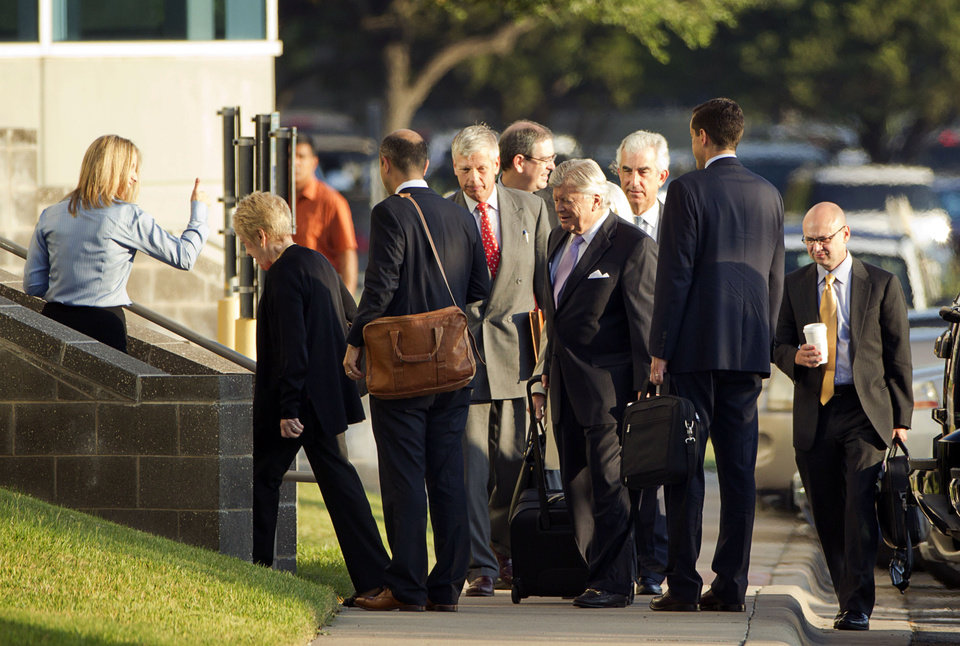 Photo - People arrive at the Dell shareholders meeting at Dell headquarters in Round Rock, Texas on Thursday, Sept. 12, 2013.  The majority of Dell shareholders voted in favor of a $25 billion buyout offer led by company founder and CEO Michael Dell.  (AP Photo/Austin American-Statesman, Jay Janner)
