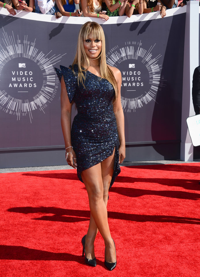 Photo - Laverne Cox arrives at the MTV Video Music Awards at The Forum on Sunday, Aug. 24, 2014, in Inglewood, Calif. (Photo by Jordan Strauss/Invision/AP)