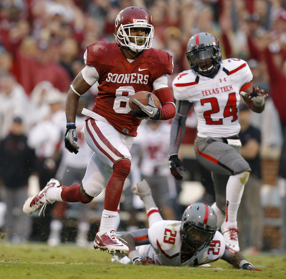 Oklahoma\'s Jalen Saunders (8) runs past Texas Tech\'s Olaoluwa Falemi (29) and Bruce Jones (24) on a 76-yard touchdown catch during a college football game between the University of Oklahoma Sooners (OU) and the Texas Tech Red Raiders at Gaylord Family-Oklahoma Memorial Stadium in Norman, Okla., on Saturday, Oct. 26, 2013. Photo by Bryan Terry, The Oklahoman