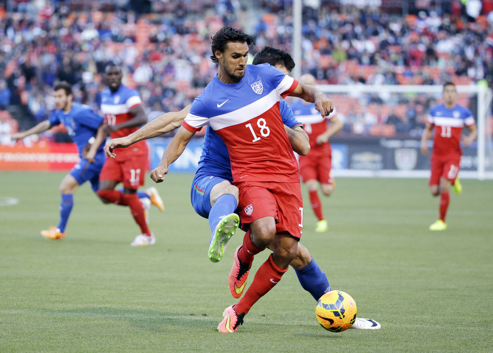 Photo - United States' Chris Wondolowski (18) is defended by Azerbaijan's Rasim Ramaldanov during the first half of an international friendly soccer match on Tuesday, May 27, 2014, in San Francisco. (AP Photo/Marcio Jose Sanchez)