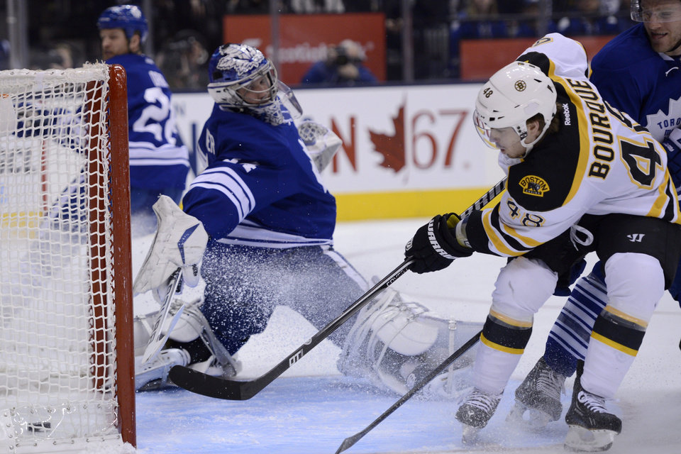 Boston Bruins left wing Chris Bourque scores on Toronto Maple Leafs goalie James Reimer during the first period of an NHL hockey game in Toronto on Saturday, Feb. 2, 2013. (AP Photo/The Canadian Press, Frank Gunn)