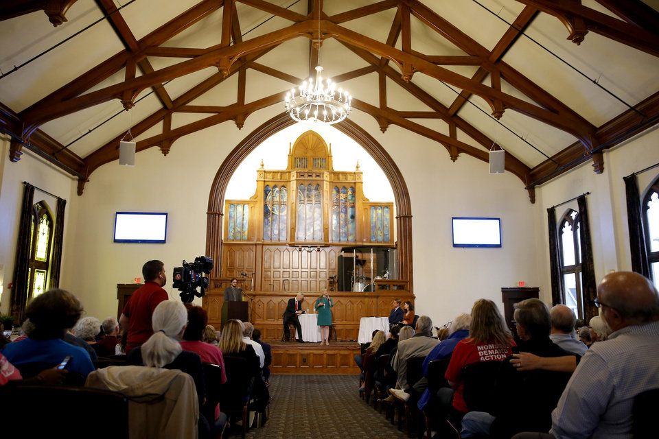 Photo -  A crowd fills City Presbyterian Church during the House 5th District candidates' debate Wednesday in Oklahoma City. [Photo by Bryan Terry, The Oklahoman]