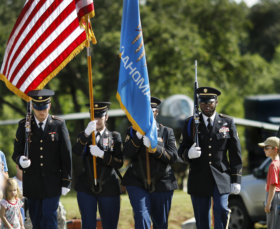 Photo - Governor's Honor Guard posts the colors during the 45th Infantry Division Museum's Memorial Day Ceremony on Monday, May 30, 2016. Photo by Jim Beckel, The Oklahoman