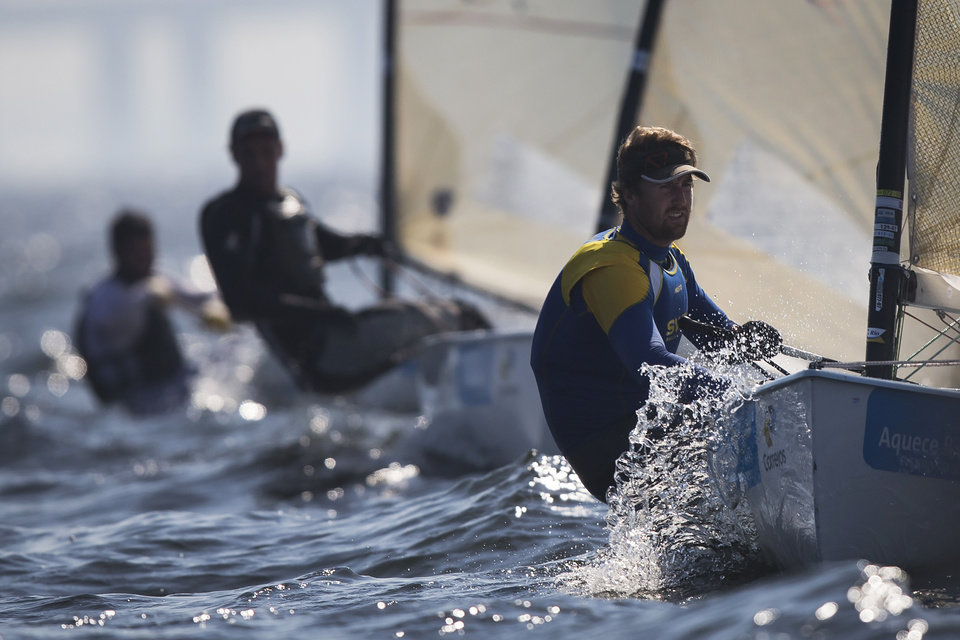 Photo - Sweden's Finn class Bjorn Allansson competes during the first test event for the Rio 2016 Olympic Games at the Guanabara Bay in Rio de Janeiro, Sunday, Aug. 3, 2014. American sailing officials have hired medical experts to test the water in Guanabara, which has suffered from decades of untreated human waste being poured into the bay. (AP Photo/Felipe Dana)