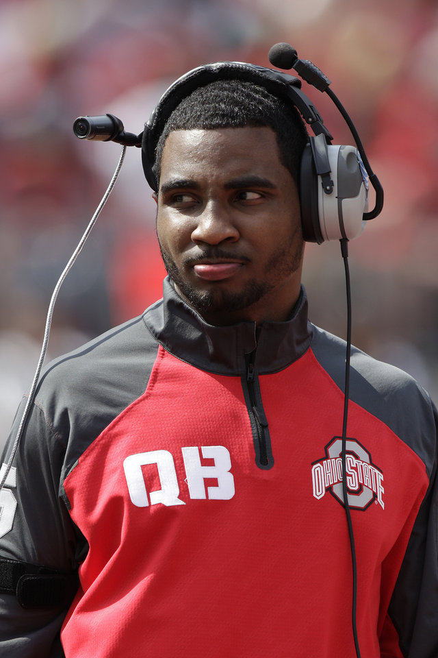 Photo - FILE - In this April 12, 2014, file photo, Ohio State quarterback Braxton Miller watches from the sidelines during their spring NCAA college football game in Columbus, Ohio.  Miller, a two-time Big Ten player of the year, tore the labrum of his (right) throwing shoulder on an unrushed, seven-yard pass on Monday. (AP Photo/Jay LaPrete, File)