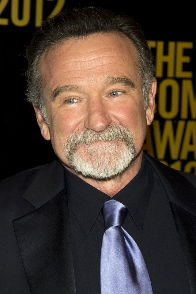 "Photo - FILE - In this April 28, 2012 file photo, Robin Williams appears onstage at The 2012 Comedy Awards in New York. Fox 2000 is developing a sequel to the 1993 hit ""Mrs. Doubtfire"" with ""Elf"" writer David Berenbaum attached to pen the script for the comedy, confirmed the studio on Thursday, April 17, 2014. While there are no deals in place, insiders say that Chris Columbus is back on board to direct and Williams will reprise his starring role. (AP Photo/Charles Sykes, file)"