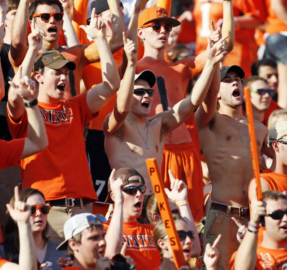 Photo - OSU fans cheer before a college football game between Oklahoma State University (OSU) and Savannah State University at Boone Pickens Stadium in Stillwater, Okla., Saturday, Sept. 1, 2012. Photo by Nate Billings, The Oklahoman