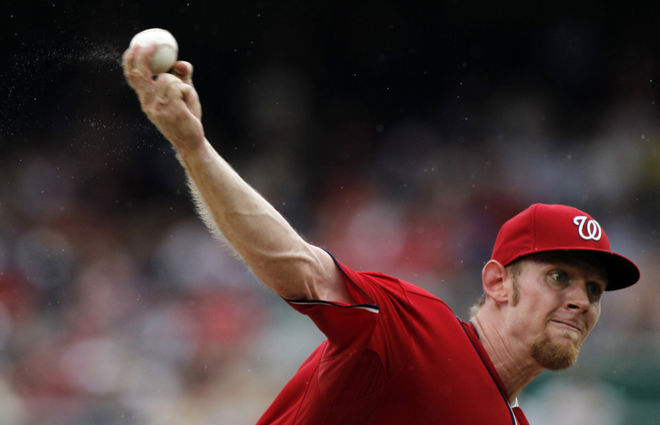 Photo -   Moisture flies off the the hand of Washington Nationals starting pitcher Stephen Strasburg during the third inning of a baseball game in the rain against the St. Louis Cardinals at Nationals Park, Sunday, Sept. 2, 2012, in Washington. (AP Photo/Alex Brandon)