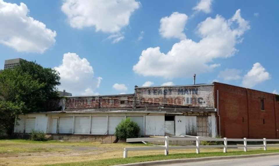 Photo -  Two warehouses at 1 E Main are set to be torn down after owner Don Karchmer convinced the Bricktown Urban Design Committee the buildings are not viable for restoration or reuse. [STEVE LACKMEYER/THE OKLAHOMAN]