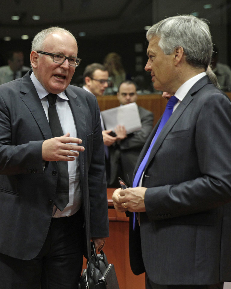 Photo - Dutch Foreign Minister Frans Timmermans, left, talks with Belgium's Foreign Minister Didier Reynders, during the EU foreign ministers council at the European Council building in Brussels, Tuesday, July 22, 2014. European Union foreign ministers are meeting to consider further sanctions against Russia because of the downing of the Malaysian jetliner, with Britain and some other countries demanding much tougher measures. (AP Photo/Yves Logghe)