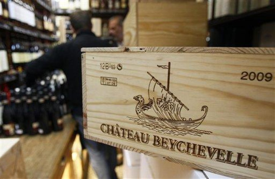 This Sept. 20, 2012, photo shows a 12-bottle wooden box of Bordeaux wine Chateau Beychevelle in a wine shop in Paris. The United States wants to sell some of their wines in the European Union with a ''chateau'' label.  Next week, EU experts will look whether it should permitted with a fight among member states set for later this year, well after the wine harvest. (AP Photo/Remy de la Mauviniere)
