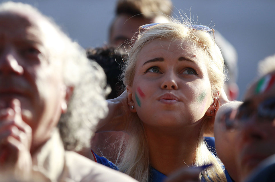 Photo - An Italian soccer fan snorts as she watches on a giant screen a World Cup soccer match between Italy and Costa Rica, in Rome, Friday, June 20, 2014.  Costa Rica won 1-0. (AP Photo/Gregorio Borgia)