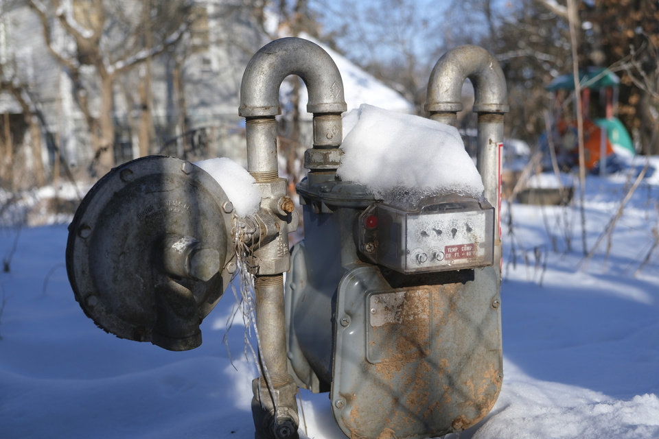 Photo - Snow covered gas meter in a backyard in Edmond, Friday, February 19, 2021. [Doug Hoke/The Oklahoman]