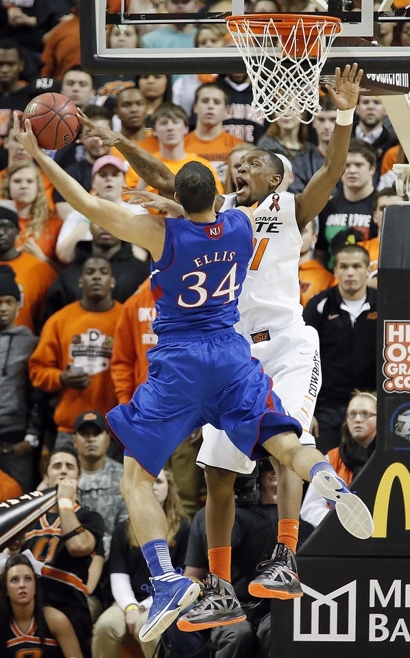 Photo - Oklahoma State 's Kamari Murphy (21) blocks a shot by Kansas' Perry Ellis (34) during the college basketball game between the Oklahoma State University Cowboys (OSU) and the University of Kanas Jayhawks (KU) at Gallagher-Iba Arena on Wednesday, Feb. 20, 2013, in Stillwater, Okla. Photo by Chris Landsberger, The Oklahoman