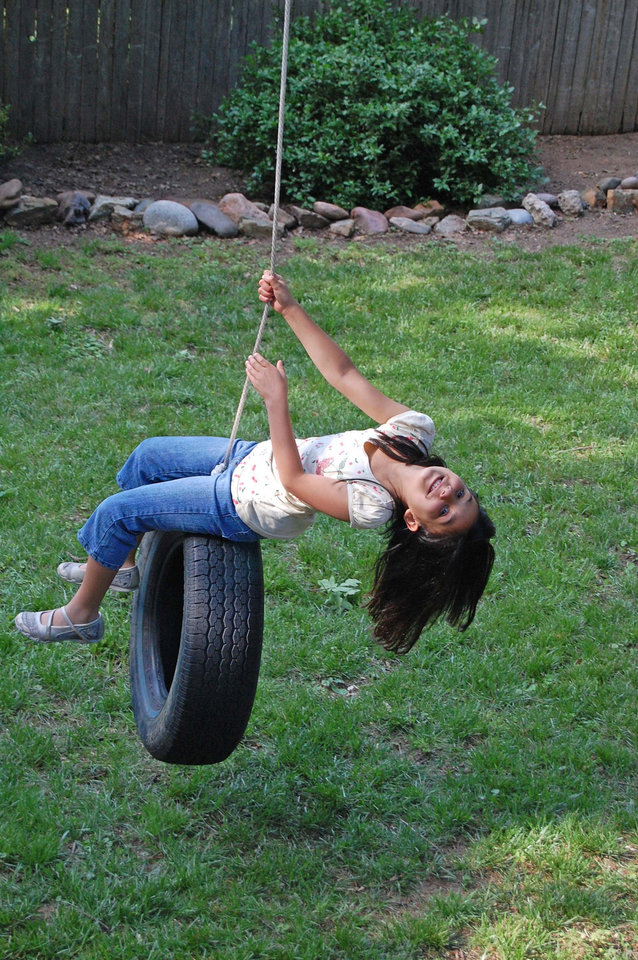 Eight-year-old Grace Mathew, my niece, enjoys swinging on a tire swing in my backyard.<br/><b>Community Photo By:</b> Cindi Tennison<br/><b>Submitted By:</b> Cindi , Bethany