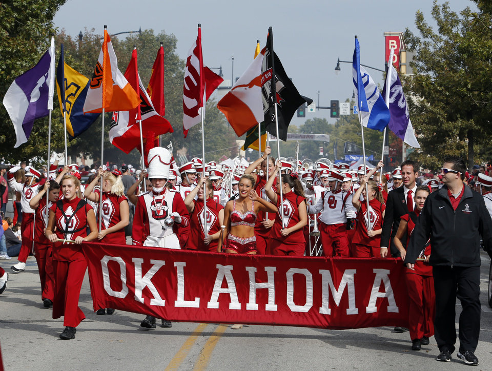 The Pride marching band leads the Homecoming Parade before the  college football game between the University of Oklahoma Sooners (OU) and the Texas Tech Red Raiders at Gaylord Family-Oklahoma Memorial Stadium in Norman, Okla., on Saturday, Oct. 26, 2013. Photo by Steve Sisney, The Oklahoman