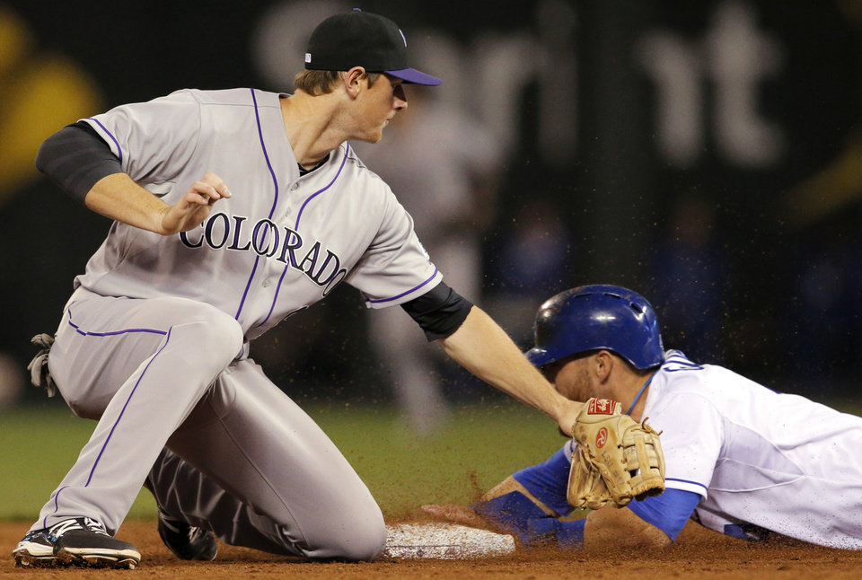 Photo - Kansas City Royals' Alex Gordon, right, beats the tag by Colorado Rockies second baseman DJ Lemahieu, left, during the fifth inning of a baseball game at Kauffman Stadium in Kansas City, Mo., Tuesday, May 13, 2014. Gordon was safe with a stolen base on the play. (AP Photo/Orlin Wagner)