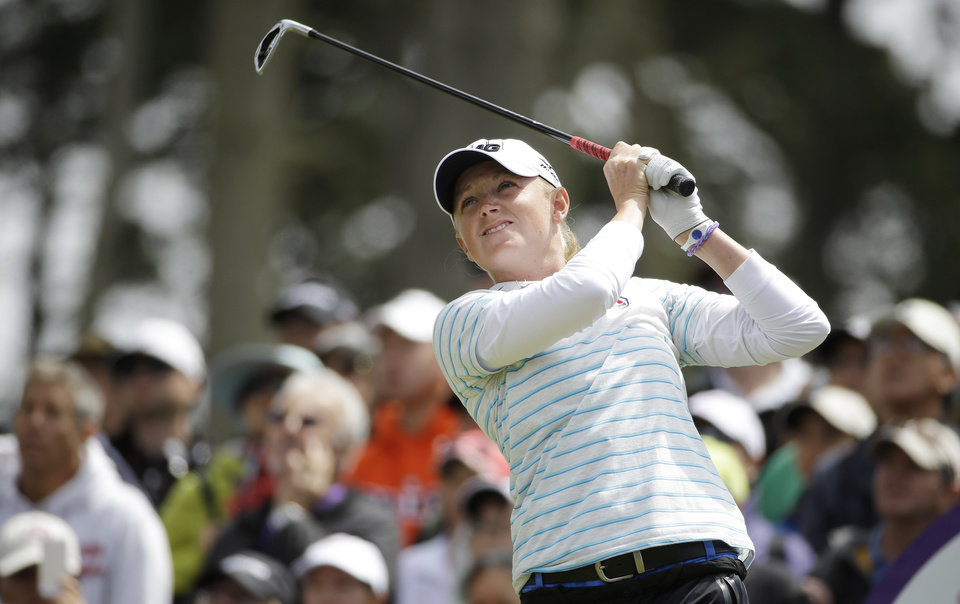 Photo - Stacy Lewis follows her shot from the third tee of Lake Merced Golf Club during the final round of the Swinging Skirts LPGA Classic golf tournament on Sunday, April 27, 2014, in Daly City, Calif. (AP Photo/Eric Risberg)