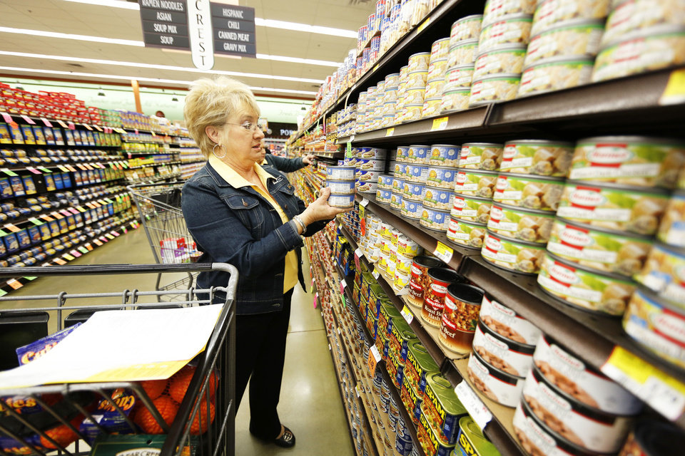 Kitty Beavers, chair of the Oklahoma Farm Bureau Women�s Committee, shops for groceries Thursday at Crest Foods. The groceries purchased will be donated to Ronald McDonald House. Photo by Steve Gooch, The Oklahoman