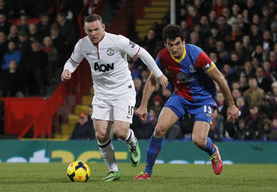 Photo - Crystal Palace's Mile Jedinak, right, competes with Manchester United's Wayne Rooney during their English Premier League soccer match at Selhurst Park, London, Saturday, Feb. 22, 2014. (AP Photo/Sang Tan)