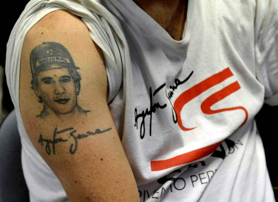 Photo - A man sports a tattoo depicting late Brazilian F1 driver Ayrton Senna, in Imola, Italy, Wednesday, April 30, 2014. It is a testament to Ayrton Senna's lasting impact on Formula One that the 20th anniversary of his death will be observed this week with five days of commemorations at the Imola track where he had his fatal accident. Current and past F1 drivers, mechanics, racing officials and fans will pay their respects to Senna and Austrian driver Roland Ratzenberger, who also died at the 1994 San Marino Grand Prix. (AP Photo/Marco Vasini)